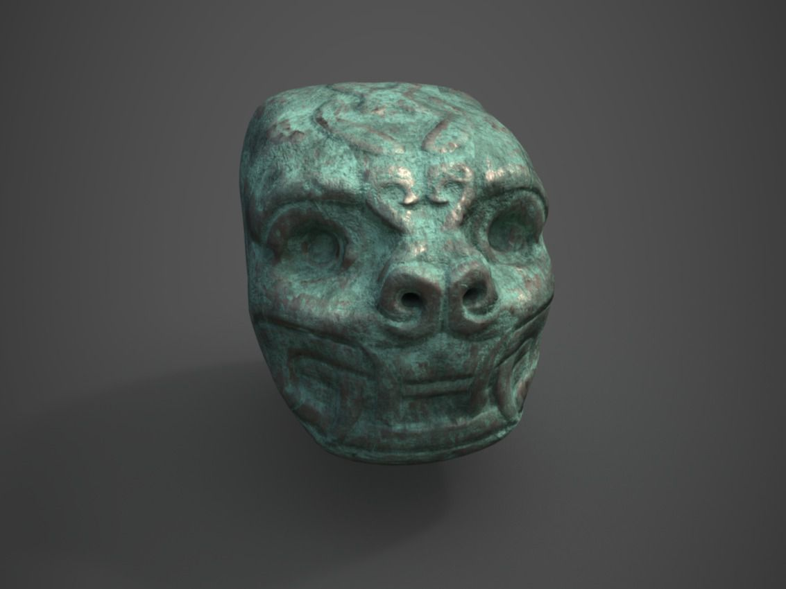 Ancient jaguar head statue